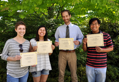 students holding Martin scholarship certificates with faculty